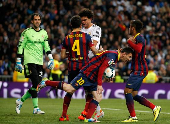 Barcelona's Lionel Messi and Neymar celebrate a goal as Real Madrid's Pepe takes Cesc Fabregas by the neck during La Liga's second 'Clasico' soccer match of the season in Madrid