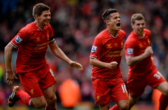 Liverpool's Courtinho celebrates scoring with Flanagan and Gerrard against Manchester City during their English Premier League soccer match at Anfield in Liverpool