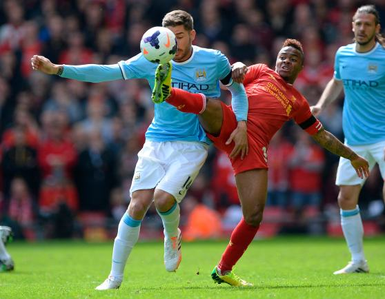 Liverpool's Sterling challenges Manchester City's Garcia during their English Premier League soccer match at Anfield in Liverpool