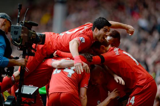 Liverpool's Courtinho celebrates scoring against Manchester City with teammates during their English Premier League soccer match at Anfield in Liverpool