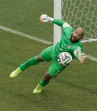United States' goalkeeper Tim Howard can't stop a shot by Germany's Thomas Mueller during the group G World Cup soccer match between the USA and Germany at the Arena Pernambuco in Recife, Brazil, Thursday, June 26, 2014. Mueller scored on the play. (AP Photo/Hassan Ammar)