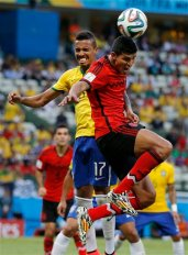 Mexico's Francisco Rodriguez, right, heads the ball in front of Brazil's Luiz Gustavo during the group A World Cup soccer match between Brazil and Mexico at the Arena Castelao in Fortaleza, Brazil, Tuesday, June 17, 2014. (AP Photo/Eduardo Verdugo)