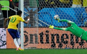 Brazil's Neymar, left, scores his sides second goal from the penalty spot during the group A World Cup soccer match between Brazil and Croatia, the opening game of the tournament, in the Itaquerao Stadium in Sao Paulo, Brazil, Thursday, June 12, 2014. (AP Photo/Felipe Dana)