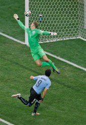 Uruguay's Luis Suarez, front, scores the opening goal past England's goalkeeper Joe Hart during the group D World Cup soccer match between Uruguay and England at the Itaquerao Stadium in Sao Paulo, Brazil, Thursday, June 19, 2014. (AP Photo/Michael Sohn)