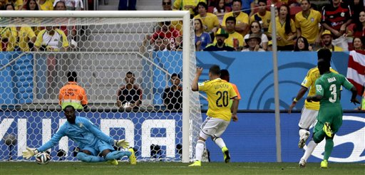 Colombia's Juan Quintero (20) scores his side's second goal during the group C World Cup soccer match between Colombia and Ivory Coast at the Estadio Nacional in Brasilia, Brazil, Thursday, June 19, 2014. (AP Photo/Sergei Grits)