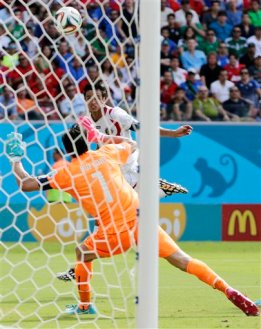 Costa Rica's Bryan Ruiz watches as he scores his side's first goal over Italy's goalkeeper Gianluigi Buffon during the group D World Cup soccer match between Italy and Costa Rica at the Arena Pernambuco in Recife, Brazil, Friday, June 20, 2014.(AP Photo/Petr David Josek)