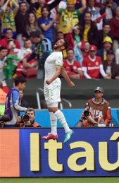 Algeria's Rafik Halliche celebrates after scoring his side's second goal during the group H World Cup soccer match between South Korea and Algeria at the Estadio Beira Rio in Porto Alegre, Brazil, Sunday, June 22, 2014. (AP Photo/Martin Meissner)