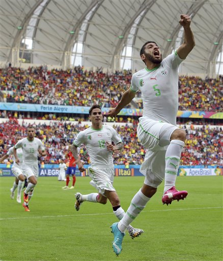 Algeria's Rafik Halliche (5) celebrates after scoring his side's second goal during the group H World Cup soccer match between South Korea and Algeria at the Estadio Beira Rio in Porto Alegre, Brazil, Sunday, June 22, 2014. (AP Photo/Lee Jin man)