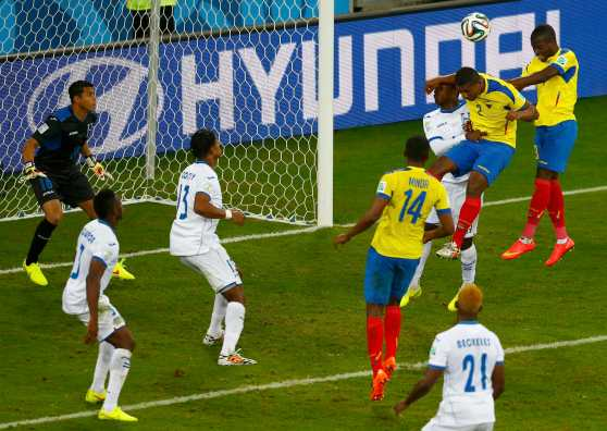 Ecuador's Valencia heads the ball to score the team's second goal against Honduras during their 2014 World Cup Group E soccer match at the Baixada arena in Curitiba