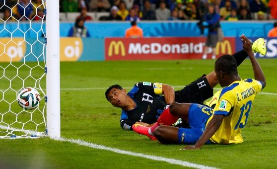 Ecuador's Enner Valencia scores past goalkeeper Noel Valladares of Honduras during their 2014 World Cup Group E soccer match at the Baixada arena