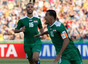 Iraq's Younus Mahmood celebrates his goal during their Asian Cup quarter-final soccer match against Iran at the Canberra stadium in Canberra