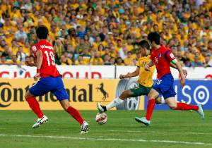 Australia's Massimo Luongo shoots to score a goal against South Korea during their Asian Cup final soccer match at the Stadium Australia in Sydney