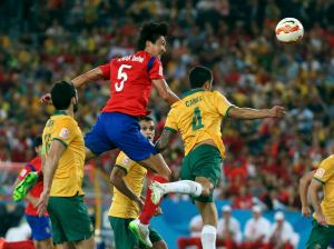 South Korea's Kwak Tae-hwi heads the ball at goal during their Asian Cup final soccer match against Australia at the Stadium Australia in Sydney
