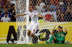 UAE's Ismail Ahmed celebrates his match winning penalty kick as Japan's goalkeeper Eiji Kawashima reacts during the penalty shoot out in their Asian Cup quarter-final soccer match at the Stadium Australia in Sydney