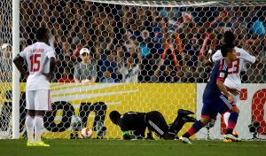 UAE's goalkeeper Majed Naser looks back after conceding an equalising goal to Japan during their Asian Cup quarter-final soccer match at the Stadium Australia in Sydney