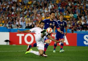 UAE's Ali Mabkhout takes a shot at goal past Japan's Maya Yoshida during their Asian Cup quarter-final soccer match at the Stadium Australia in Sydney