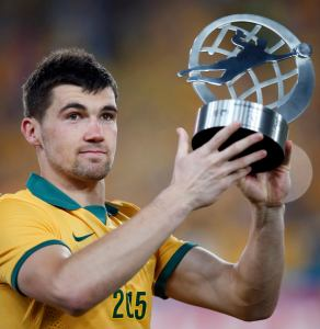 Australia's Mathew Ryan holds up his trophy for best goalkeeper during the trophy presentation ceremony of the Asian Cup at the Stadium Australia in Sydney